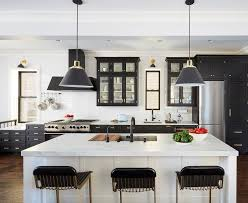 black glass front kitchen cabinets with brass pulls
