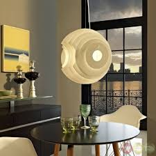 pendant lighting for dining table. contemporary modern pendant lighting design over round dining table and white chair set for 2 person