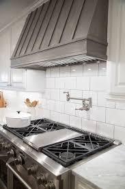 Black Brick Subway Tile Backsplash In The Kitchen With White Large