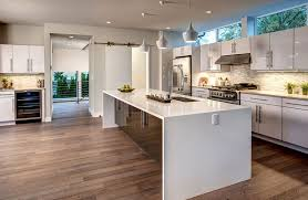 contemporary kitchen with waterfall island with corian countertop