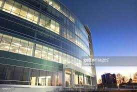 glass exterior modern office. modern glass office building at sunset exterior l