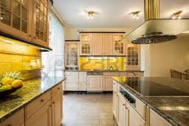 kitchen island close up. kitchen island unit: close-up of granitic countertop in luxury stock photo close up