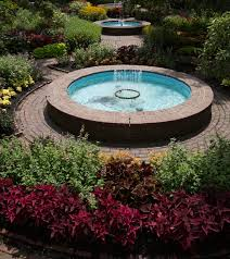 the three fountains in prescott park s formal garden are ringed with annuals such as coleus creeping zinnias and salvias along with tender perennials