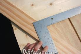 framing square to cut angles on a barn door