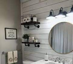 On the shelf, there is an element of nature, a flower, and some other decorations. Decorative Farmhouse Bathroom Wall Decor Ideas You Ll Love Decorating Ideas And Accessories For The Home Creative Ideas For Every Room