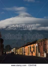 ... Colonial Spanish buildings facades painted with bright colors, beneath  a towering volcano, in the