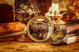 vine book p telescope and a pocket watch lying on ancient world map in 1565 stock photo colourbox