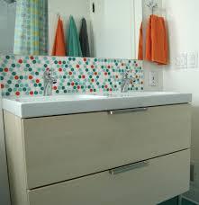 Bathroom vanity backsplash with penny tiles
