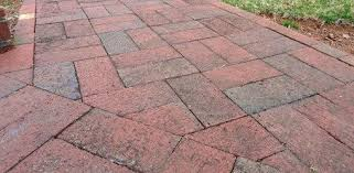 between brick and concrete pavers