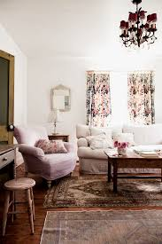 boho chic furniture carpet hardwood floor stool armchair sofa pillows mirror lamp window curtain table living