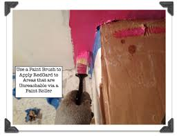 use a paint brush to apply redgard to areas that are unreachable via paint roller