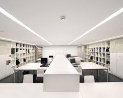 luxury white nuance interior design architecture design studio that has white shelves on the black modern architecture office interior