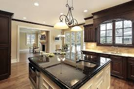 kitchens with black granite counters kitchen with brown cabinets and light color counter with white cabinet