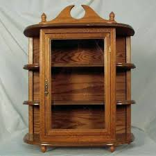 oak wall curio cabinet oak hanging wall mounted curio cabinet with glass door 2 oak wall