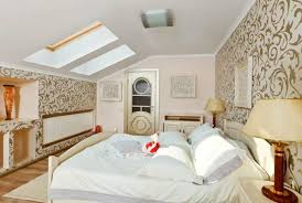 attic furniture ideas. attic bedroom design with two beds and creative wall painting kids room furniture ideas