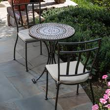 simple dark wrought iron outdoor bistro set table and chair metal with white cushion seat on pavers flooring garden furniture ideas patio chairs piece