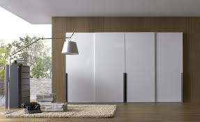 ... Contemporary wardrobe / wooden / lacquered wood / sliding door CHIC by  Fernando Salas and Jordi ...