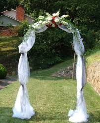 best 25 wedding arch tulle ideas on pinterest wedding alter Wedding Decoration Ideas Using Tulle wedding arch covered with tulle and accented with flowers wedding decoration ideas with tulle