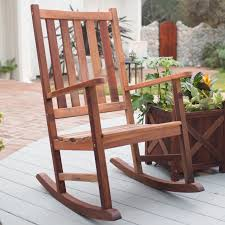 rustic rocking chairs with outdoor potted plant