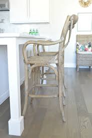 x back wooden bar stool white kitchen carrara marble grey hardwood floors