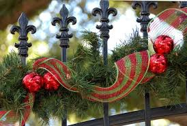 If you have a fence at the entrance of your home or a door, tie Christmas  wreaths and red ribbons there.