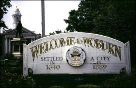 a civil action summary a sign reading quotwelcome to woburnquot