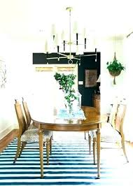 rug under dining room table what size rug for dining room fascinating should you put a