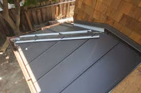 standing seam steel roof being installed 1500 x 1000 how to install steel roofing 162
