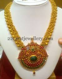 antique long chain with ruby pendant
