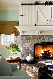 wood trim fireplace mantel stone wall fireplace bedroom traditional with family room family room