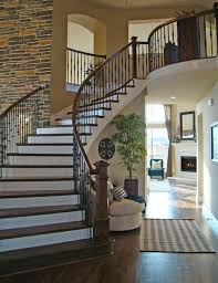 love the brick wall curved stair dream home ideas
