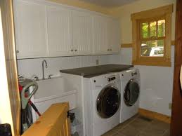 folding counter above front load washer and dryer traditional laundry room