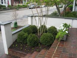 how to build retaining wall for patio easy building with concrete blocks stack of brick pavers