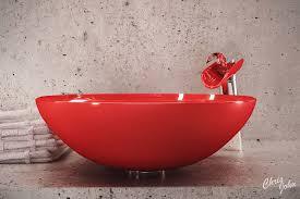a red bowl vessel of bathroom sink