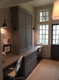 home office for two features gray cabinets adorned with bronze knobs flanked by built in adorable office library furniture full size