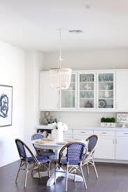 simply sutter kitchen nook beaded chandelier white kitchen bistro chairs lighting fixtue white walls kitchen nook7160