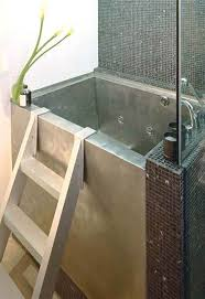 japanese soaking tub small in silver with stairs and impressive tile on  bathroom wall suitable for