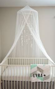 Crib and canopy from Ikea. Crib sheet: Pottery Barn. Grey linen crib skirt