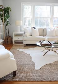 cowhide rug for layering living room style
