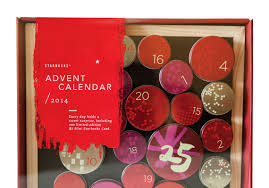 the starbucks advent calendar is a magnetic chalkboard with 25 reusable tins