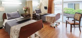 comfortable beds with wood flooring and a chair