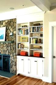 built in bookshelves around fireplace cabinet next to cabinets a custom ins pictures cabine