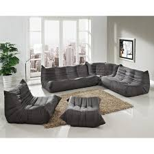 Where To Place A Rug In Your Living Room Contemporary Unique Shape Gray Sectional Sofa With Ottoman Coffee