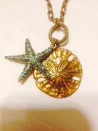 rejoice designs brass sand dollar and star fish with swarovski crystals