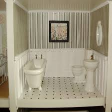 Wainscoting Bathroom Ideas With Wall Art And Bathtub And Sink ...