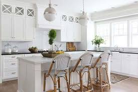 french bistro lighting. glass and chrome pendant lights in an allwhite kitchen with french bistro style lighting