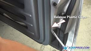 how to remove a door panel in less than minutes once all mounting screws or bolts and plastic mounting clips have been released or removed lift up on the door panel to release it from the window sill