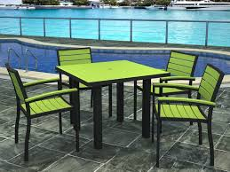 neon green patio table with 4 matching chairs