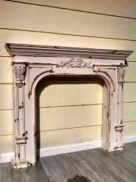 a reion of a vintage french country farmhouse fireplace mantel it has a unique distressed finish that looks as though it has weathered
