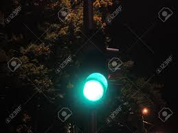Stop Light At Night Traffic Light At Night Time Showing Green